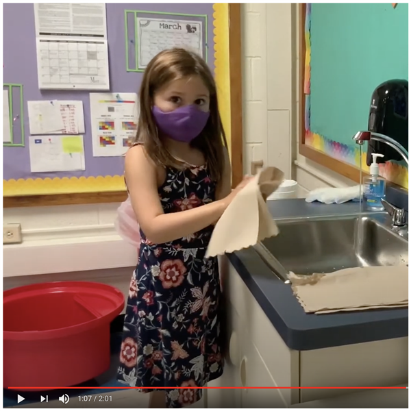 video still of child at sink